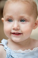 Close_up of a baby girl smiling