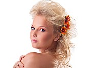 Beauty naked woman portrait with flower blond hair