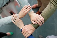 Close-up of connecting hands of business executives (thumbnail)