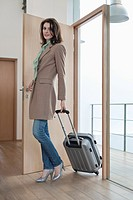 Woman arriving at home from vacations (thumbnail)