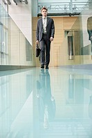 Businessman walking in an office corridor