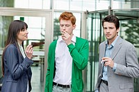 Business executives smoking in front of an office building (thumbnail)