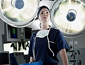 Portrait of confident nurse under surgical lights