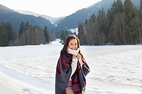 Portrait of smiling woman in snowy field (thumbnail)