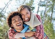 Portrait of enthusiastic couple piggybacking