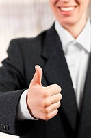 Thumb up success sign gesture