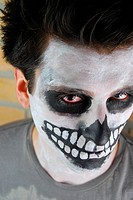 portrait of a creepy skeleton guy perfect for Carnival brick wall background
