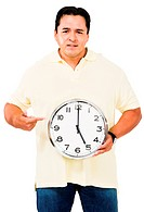 Mid adult man pointing at clock