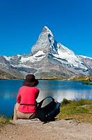 Female Japanese tourist watching Matterhorn at Stellisee lake, Zermatt, Wallis or Valais, Switzerland