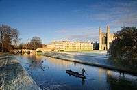 View of river with punt approaching bridge and college buildings in frost, Clare Bridge, Jerwood Library, Trinity Hall, Clare College and King´s Colle...