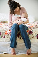 Mother feeding baby boy 2_5 months using feeding bottle