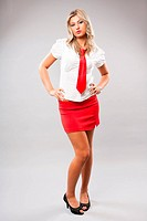 Sexy businesswoman in red skirt and tie