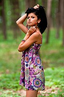 Attractive hispanic girl in the forest