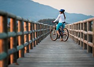 A cyclist on a wooden boardwalk, tarifa cadiz andalusia spain