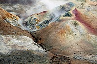 Steam above colorful sulfur field at the Krafla Vulcano at Lake Myvatn, Iceland