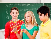 Pupils in class holding molecular model