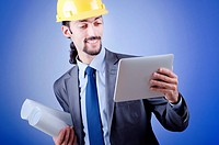 Construction worker working on tablet