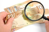 Magnifying glasses with Canadian Dollar