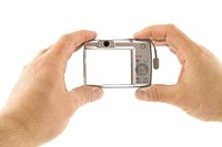 The digital camera in a hands isolated over white background