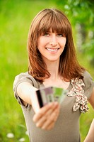 Young woman holding several credit cards