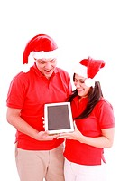 Couple enjoying their new touchpad on christmas