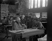 Portraits of Frank Lloyd Wright and others at Taliesin East, 1937 Dec. , Frank Lloyd Wright at a drafting table with three onlookers negative , Includ...