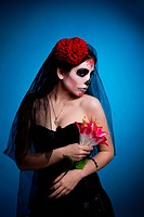 woman in skull face art mask All Souls Day