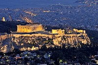 View of Acropolis of Athens from Lykavittos hill during dusk time, Greece