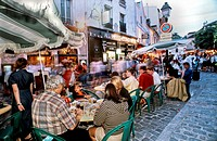 PARIS, France - Family Sharing Meal on Restaurant Terrace, on Street, in Montmartre Area