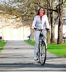 Girl walks city with bicycle