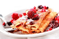 Crepes filled with chocolate and berries