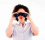 Young businesswoman searching for something with binoculars