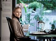 Caucasian businesswoman sitting at desk
