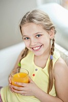 Portrait of girl drinking orange juice
