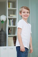 Portrait of a young boy in casuals smiling at home