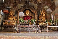 A Buddhist shrine with three golden Buddhas, Inle Lake, Burma