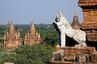 A lion statue on the corner of a temple in Bagan, Burma