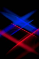 Blue and red lights crisscrossing against a black background (thumbnail)