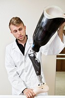 Young technician working on prosthetic leg