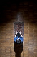 A man praying on a mat (thumbnail)