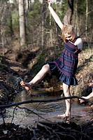 Girl kicking her feet through the water in Mooresville, North Carolina, USA