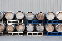 Stacked wine barrels at a winery