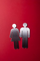 Female and male restroom sign figures holding hands