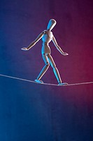 An artist's figure walking a tightrope (thumbnail)