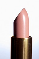 A pink lipstick, close_up