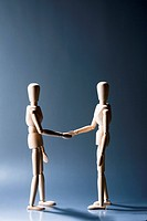 Two artist's figures shaking hands