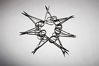 A group of surgical scissors arranged in a star shaped pattern