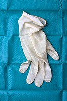 A surgical glove on a surgical drape