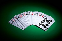 Cards fanned out on a gambling table (thumbnail)