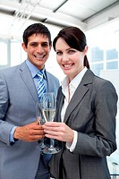 Two smiling colleagues drinking Champagne